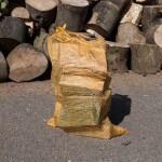 Net bag of seasoned hardwood and offcuts, as well as firewood logs, from Treesaw