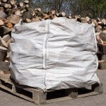 Builders bag of firewood logs, offcuts and seasoned hardwood
